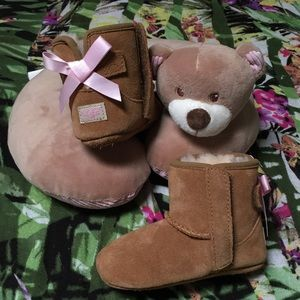Uggs with baby pink bows.